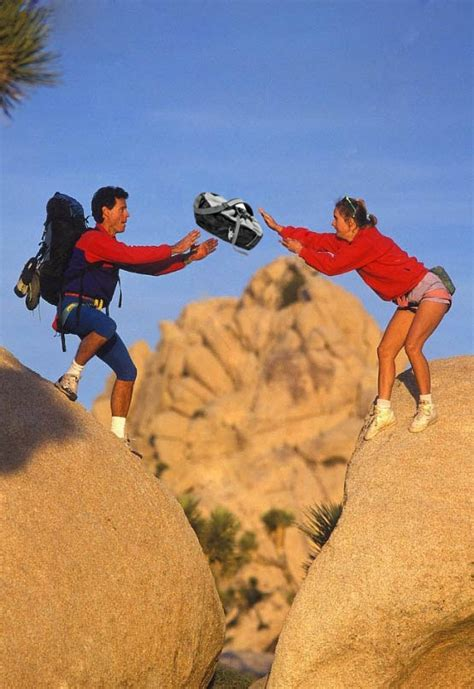 Photo of climbing couple tossing baby: Real or fake
